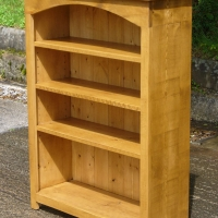 Rustic plank style bookcase finished in antique pine