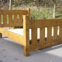 Slat bed with high foot board